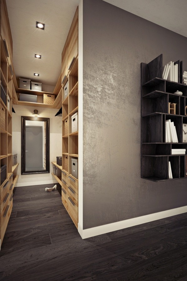 A walk-in closet eschews doors while boxes and cubby holes keep unmentionables out of view.