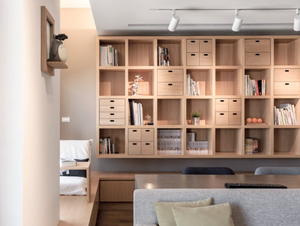 The massive custom shelving unit includes built-in drawers for those trinkets that are not quite ready for display.