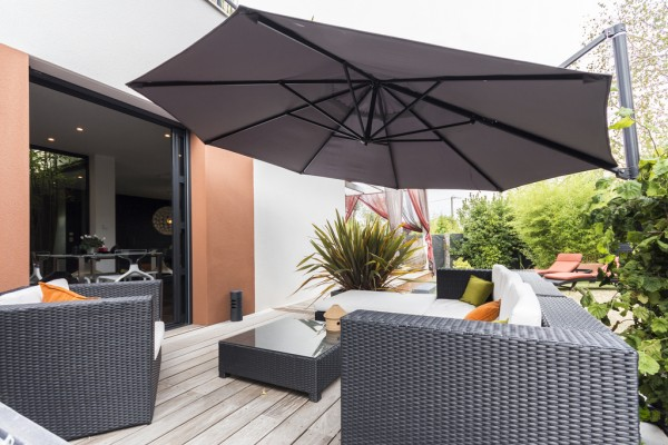 Another outdoor area is shaded by a clever collapsible umbrella.