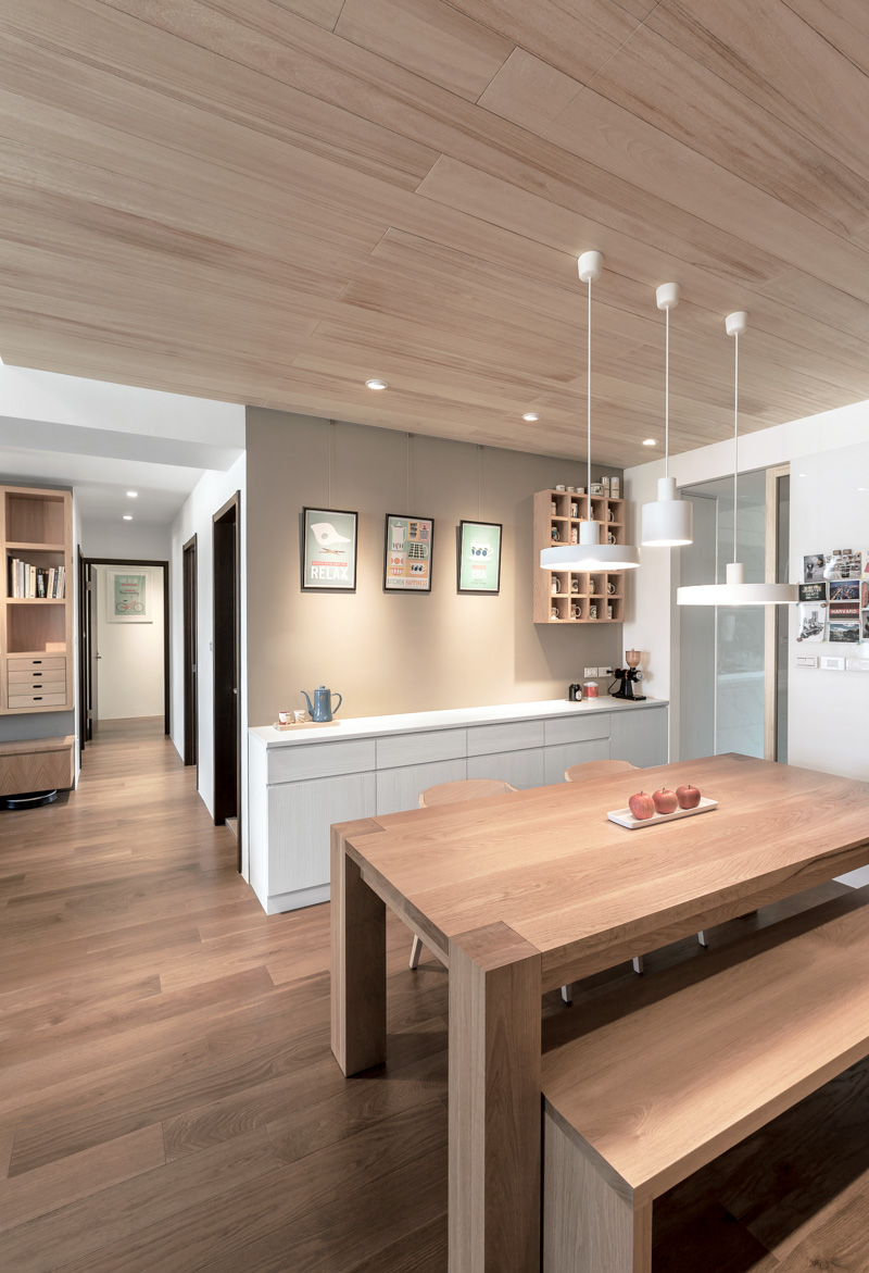 a modern apartment celebrates the look of natural wood