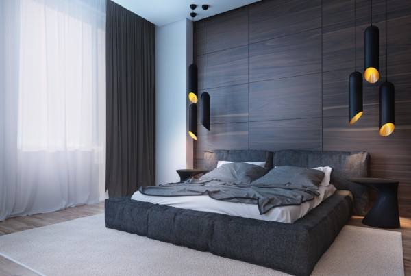 The bedroom uses a large dark wood accent wall that takes the place of a headboard.