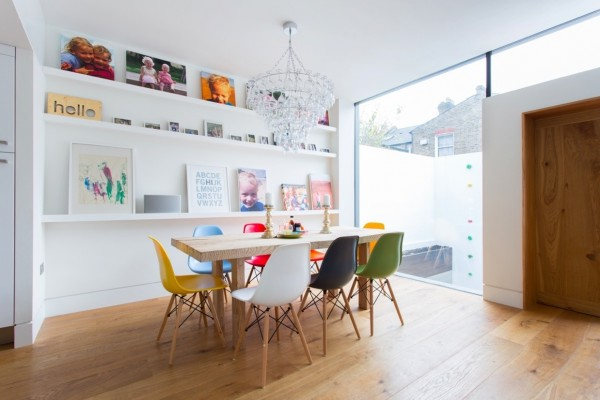 In this playful dining room, the designer has chosen a rainbow of Eames chairs which work nicely against the warm wooden floor and white walls. This would be a perfect space to play host to a special sleepover dinner party.