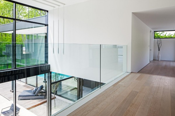Upstairs, a glass divider acts as a simple railing for the balcony area.