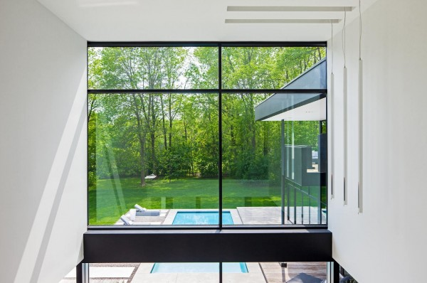 The two-story windows offer views of both the back yard....