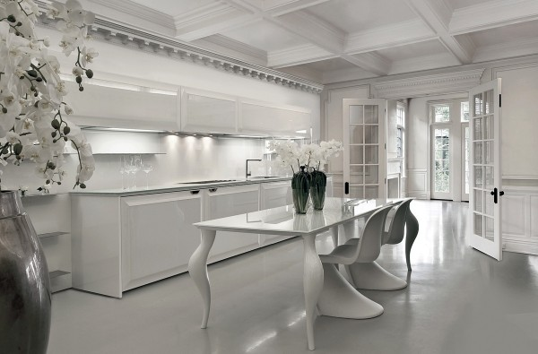 Curved legs, chairs, and vases offer a feminine bent to this kitchen.