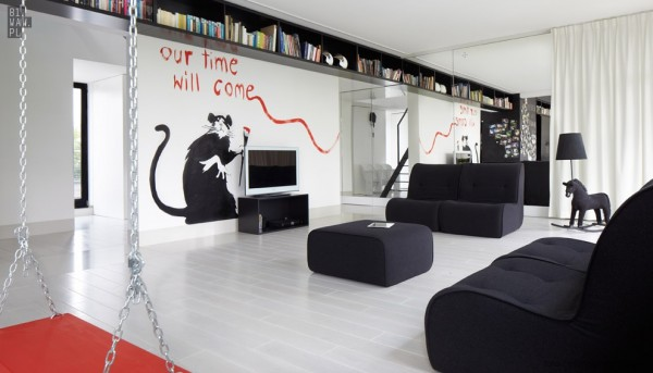 In this first home, we can see the interior immediately come to life with the Banksy-inspired mural in the living room.