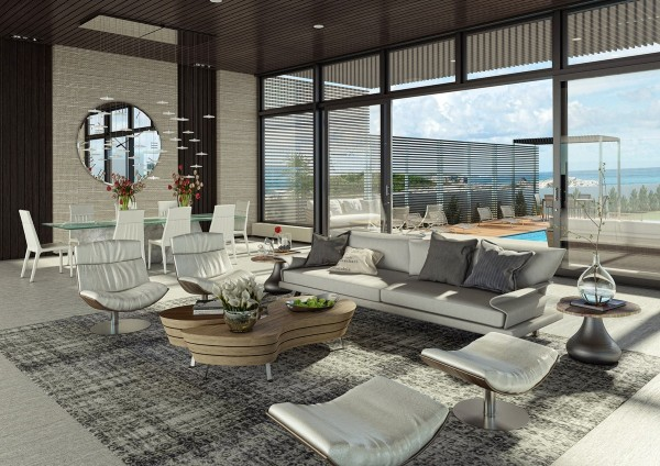 Plenty of luxury seating and a view of the pool makes this living room the ultimate indulgence.
