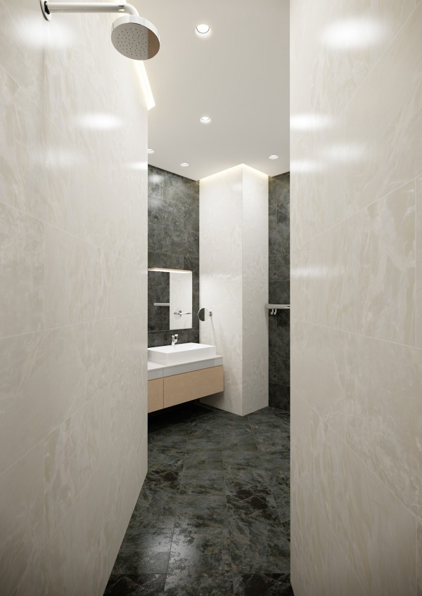 Surrounding the second bathroom in marble tiles makes it like a chamber of privacy.