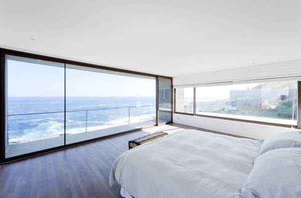 A minimalist bedroom has its own private balcony and buckets of sunlight.