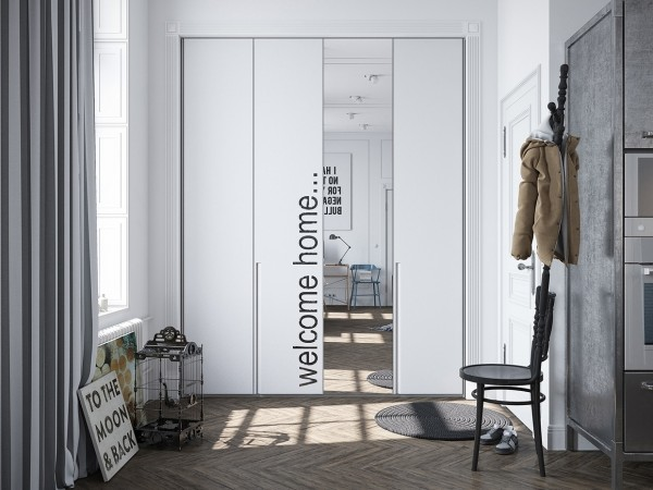 An artistic mirror sits at the entrance to the apartment with a lovely typographical accent.