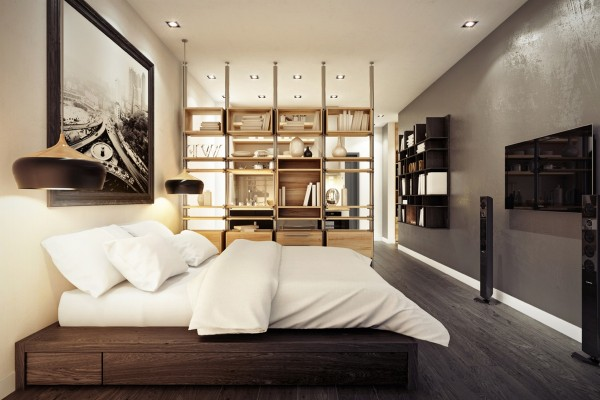 A beautiful wood platform bed is separated from the main room of the home by custom floating shelves.