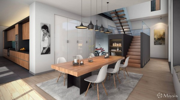 This open dining room takes advantage of high ceilings and an airy floor plan in its design. The simple and delicate molded chairs contact the formidable wooden table, which leaves plenty of room for even the most elaborate meal.