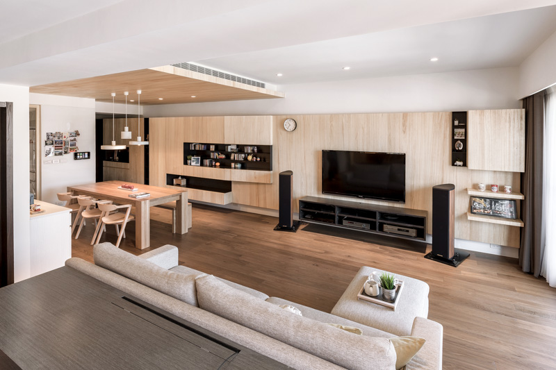 A modern apartment celebrates the look of natural wood for Modern living room plan