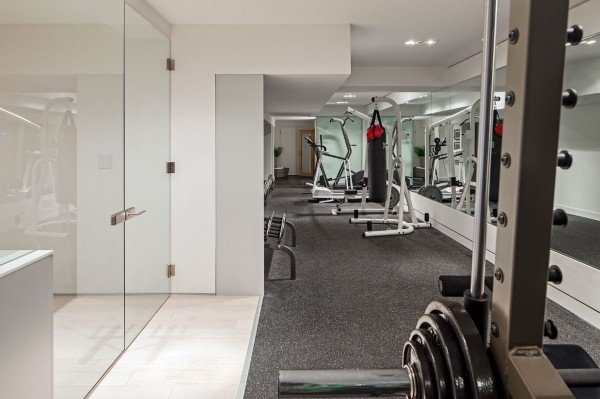 ...and private gym leave this modern home wanting for nothing.