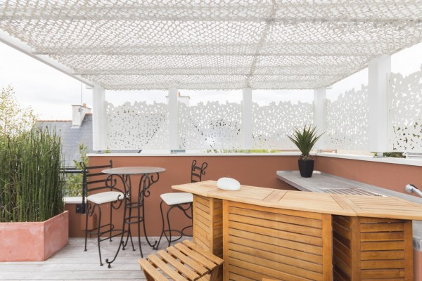 An outdoor bar area will surely attract the neighbors.