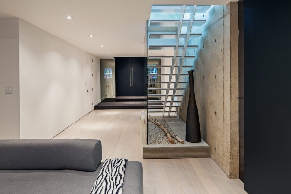 The use of space under the stairs gives the basement a warmth it may otherwise lack, with no windows.