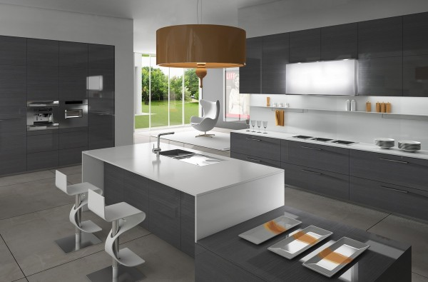 A more modern option for kitchen islands, this one uses a bright white countertop and funky chairs.