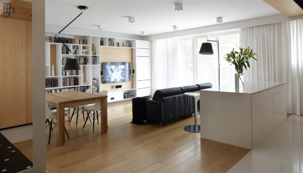 The clean lines and simple furniture leave plenty of space for a living area, small dining table, and kitchen area.