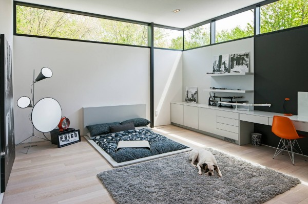 In one bedroom, we find a truly awesome sunken bed design and cozy shag rug, perfect for dogs and humans alike.