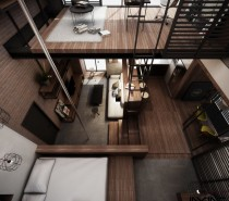 A ladder leads up to the lofted workspace, a much more space efficient choice than stairs.