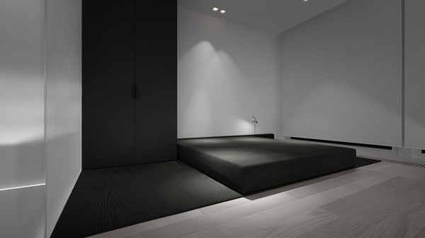 The texture of the platform also stands in beautiful contrast with the smooth charcoal closet doors.