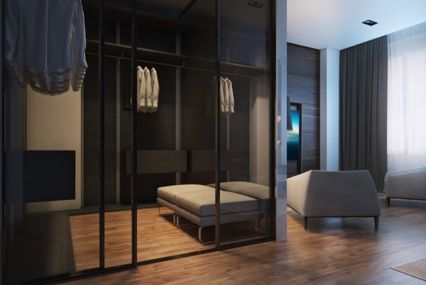 The walk-in closet has a dressing area and class doors for an open, airy feeling.
