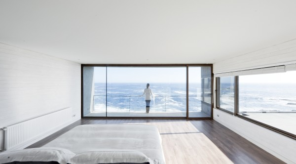Windows on two sides of this bedroom give a sense of a space that never stops, almost as if you were on a ship at sea.