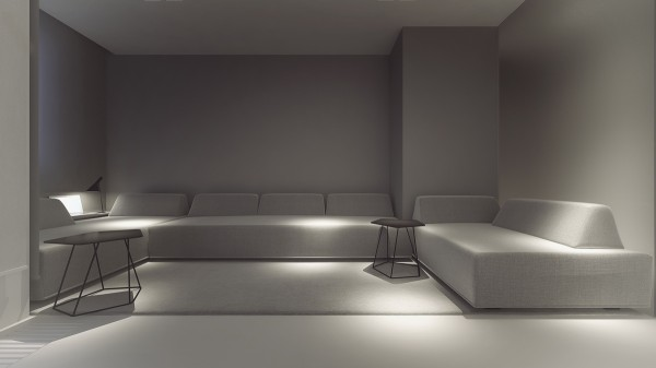 These deep gray sofas could easily double as sleeping surfaces.