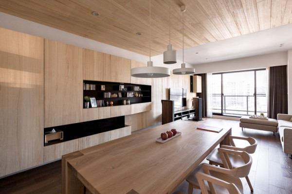 The natural grain in the ceiling and dining table really makes the whole apartment feel bigger and even more open than it is.