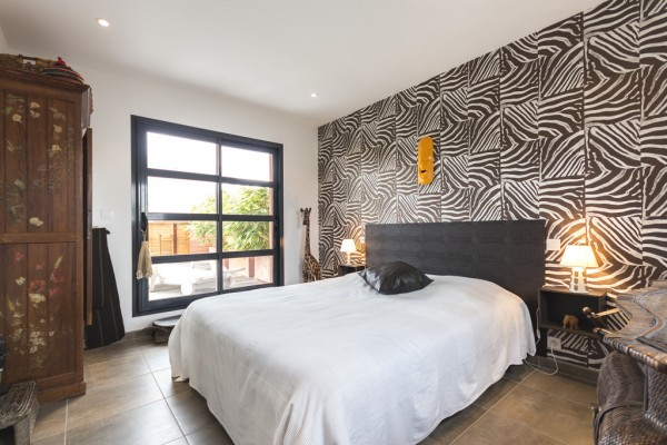 Here a unique zebra print wall treatment is bold but not dizzying.