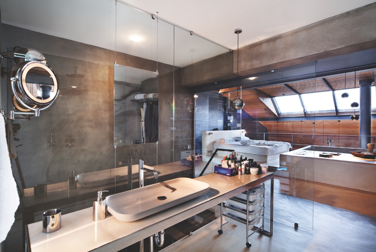 Bachelor Bathroom Design - Karakoy loft uses rich wood features and creative industrial elements