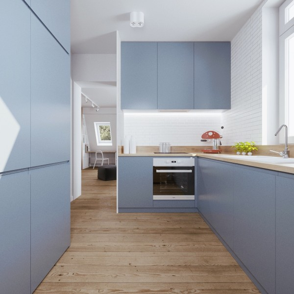 Due to the minimal square footage and the slated ceilings, the pale blue kitchen actually had to be split into two parts.