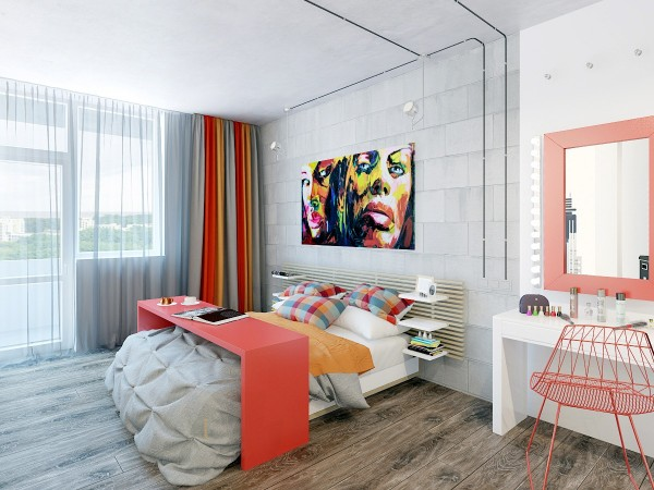 In the bedroom we find one of the most common loft elements: a concrete wall. Pairing the cool grey with oranges and red, the room immediately becomes more welcoming.