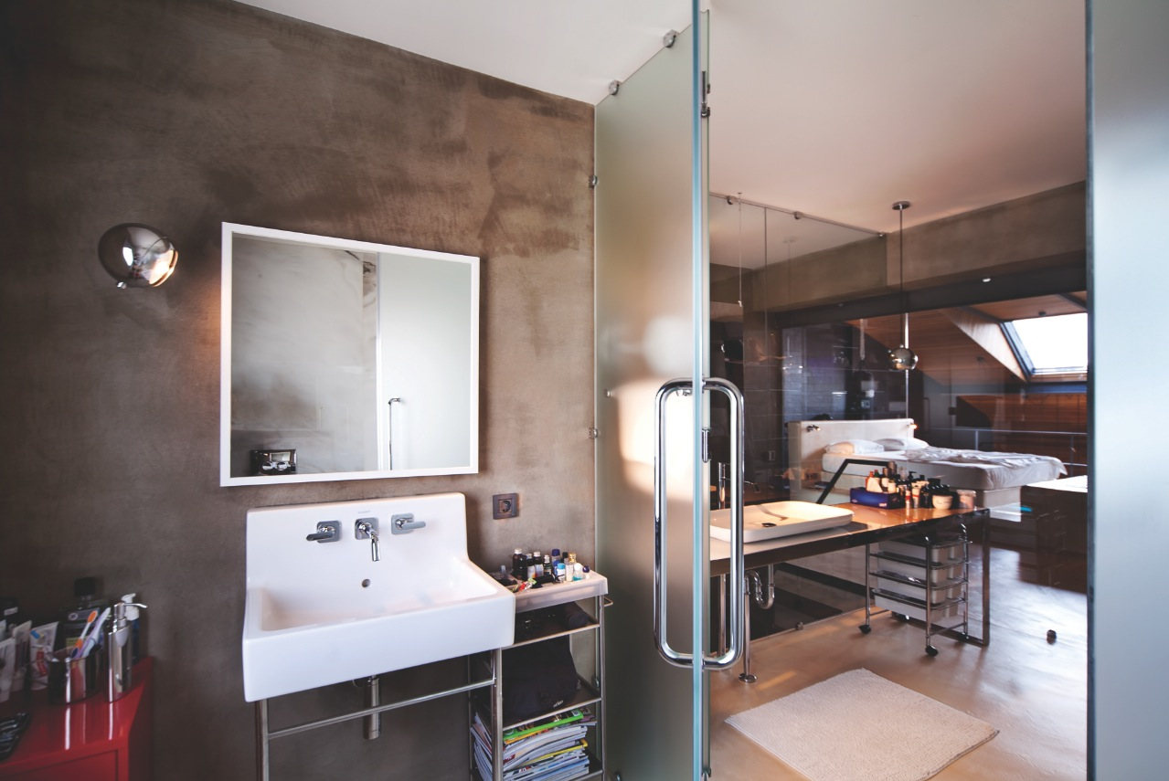 Concrete Bathroom Design - Karakoy loft uses rich wood features and creative industrial elements
