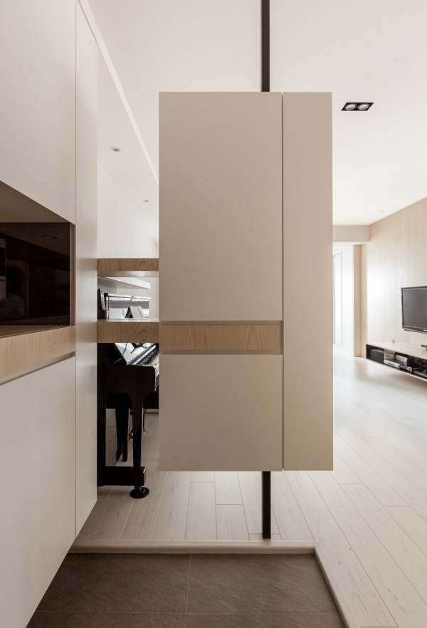 This cool custom room divider marries the look of light wood and white. It keeps the kitchen separate from the dining and living rooms, but doesn't close anything off.