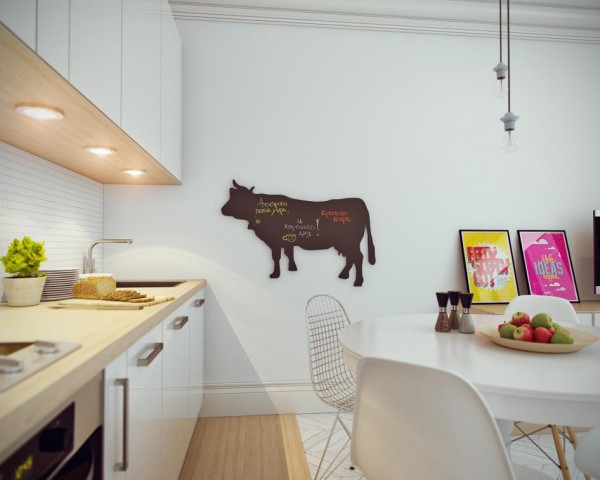The cow-shaped chalkboard is a whimsical touch but also useful for meal planning and grocery shopping.