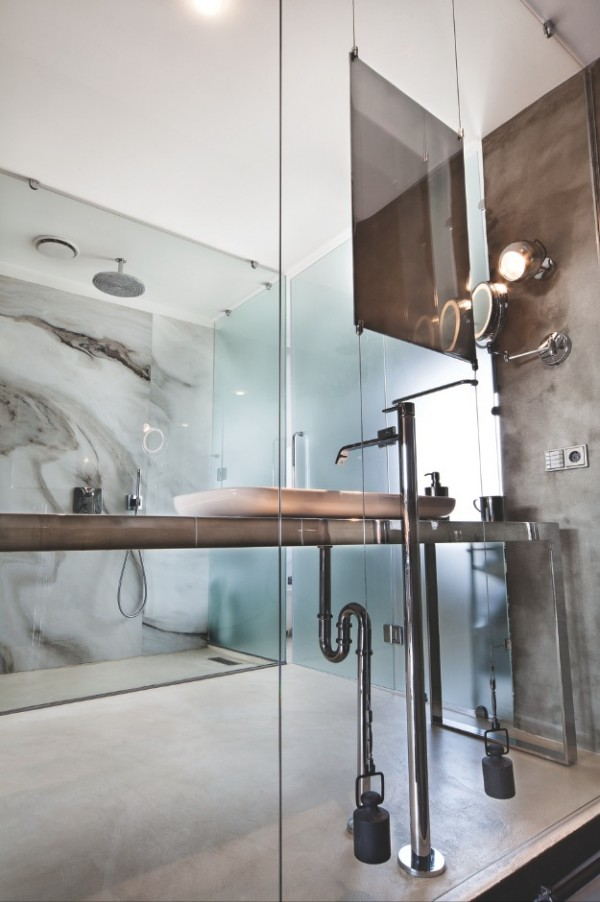 Exposed plumbing at this bathroom sink is the height of industrial chic.