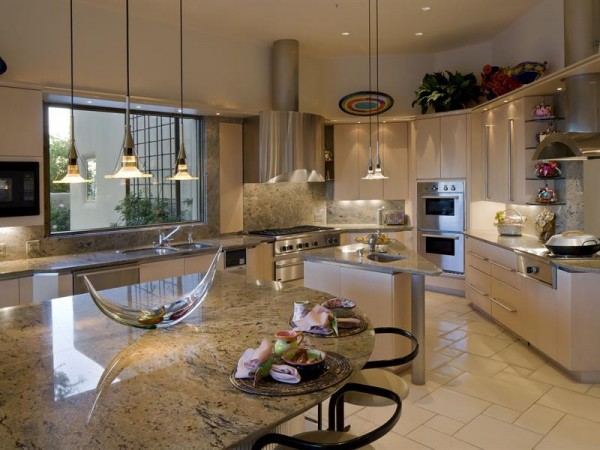 Granite countertops and stainless steel fixtures in the expansive kitchen are timeless, though.