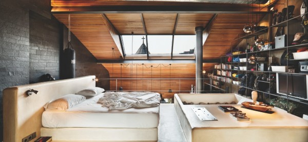 The lofted bedroom is simple and sunny.