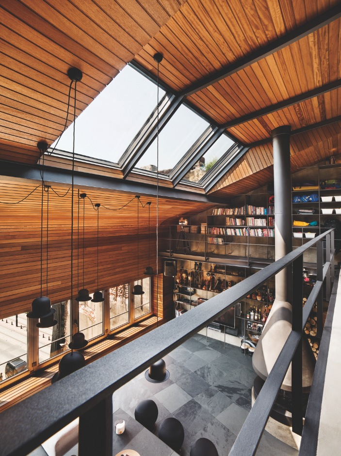 Loft Catwalk - Karakoy loft uses rich wood features and creative industrial elements