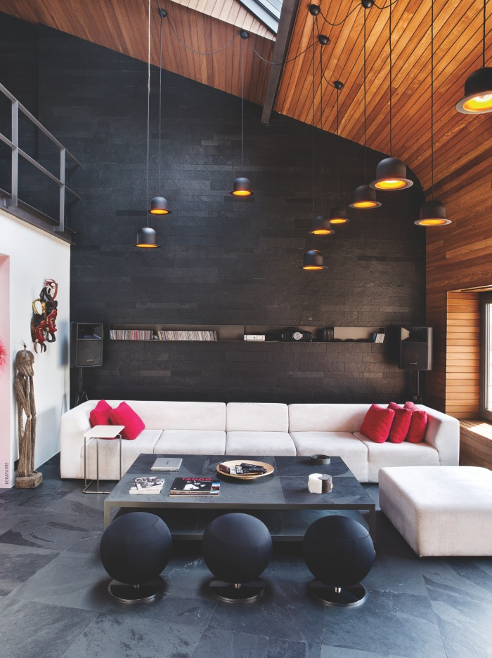 Loft Living Room - Karakoy loft uses rich wood features and creative industrial elements