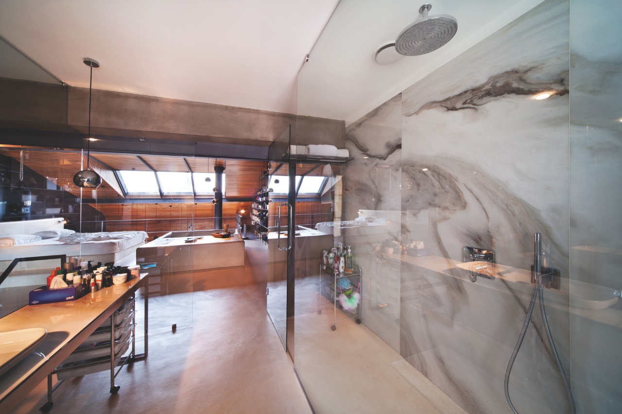 Marble Bathroom - Karakoy loft uses rich wood features and creative industrial elements