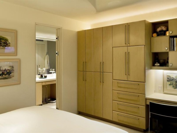 Custom cabinetry in the master bedroom offer plenty of storage.