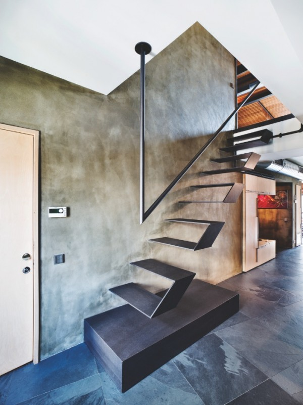 A creatively affixed handrail comes down from the ceiling but does not sacrifice style for safety.