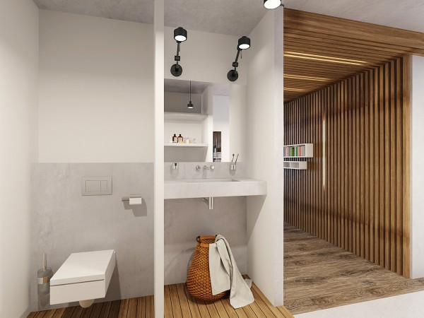 The bathroom, kept mainly in white and natural wood, is actually open to the main room, but tucked behind a wall for privacy.
