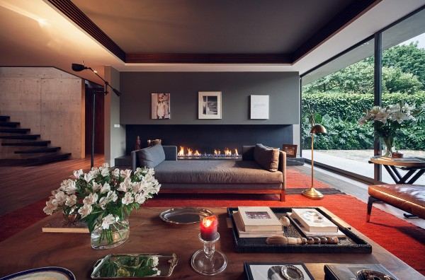 Wide, low sofas, coffee tables, and even fireplace invite guests to stay and lounge as long as they like.