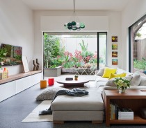 The photos in this post focus on the rear addition to the house, which includes three levels, beginning with this open and sunny living area.