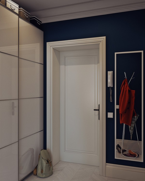 The designers pull dark blue into the entryway with these stunning walls.