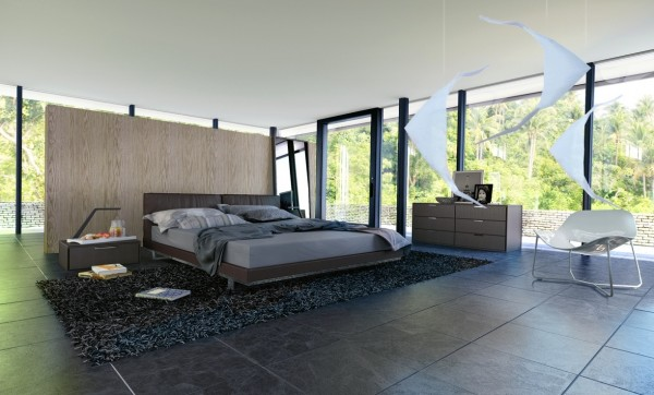 A wall behind the bed offers the tiniest bit of privacy in this otherwise glass-encased bedroom.