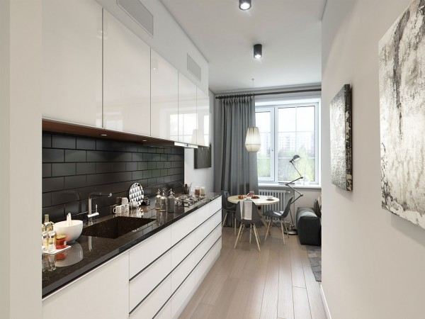 The use of neutral colors, which extends into the narrow kitchen, makes the space feel more open and calm, despite the lack of extra floorspace.